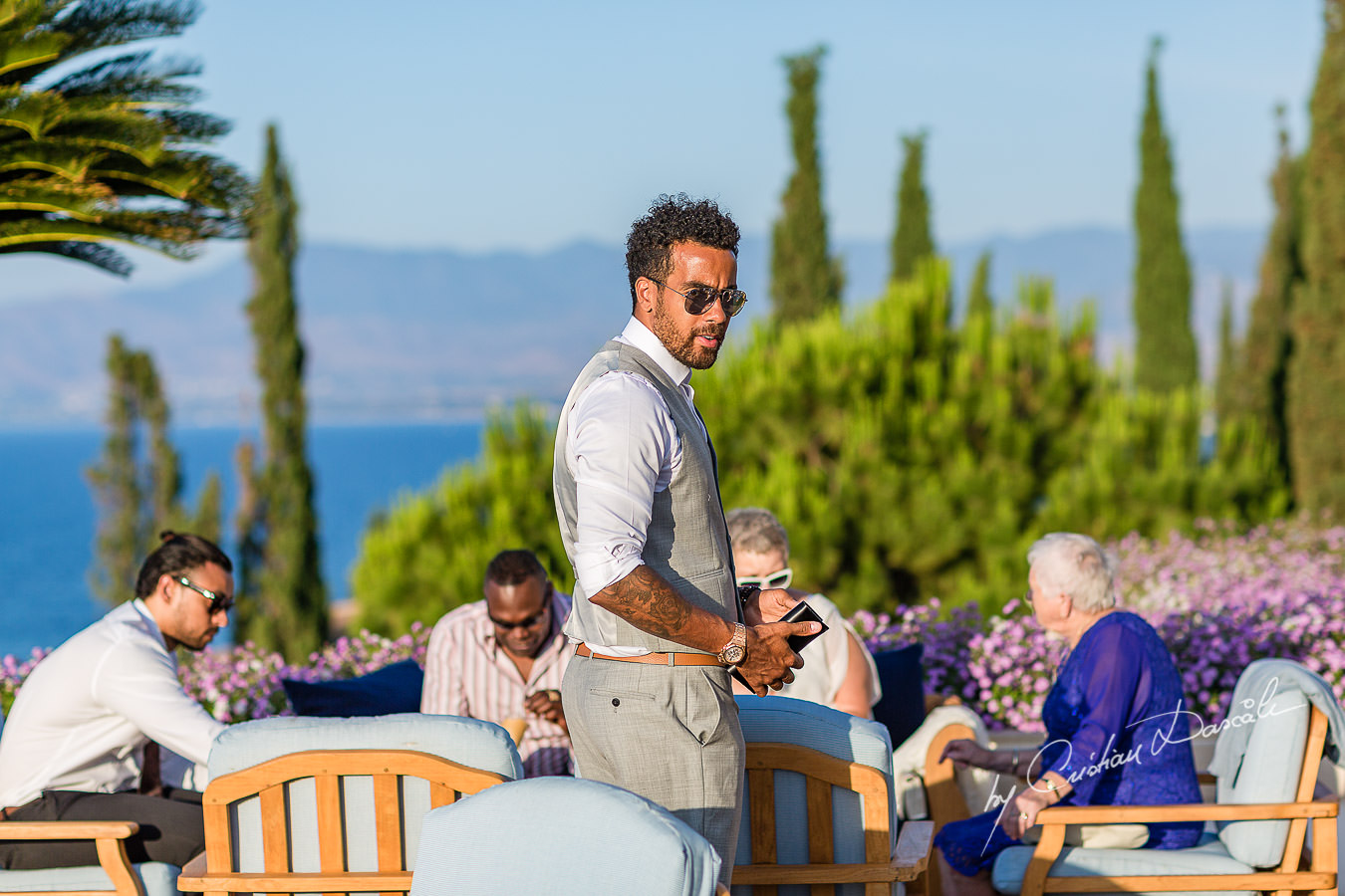 The father of the baby just Christened at the beautiful Anassa Hotel photographed by Cyprus Photographer Cristian Dascalu.