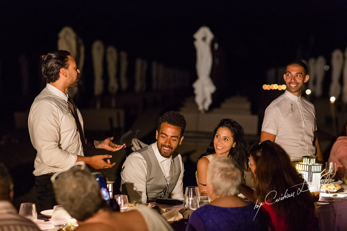 Guests chatting at the beautiful Anassa Hotel photographed by Cyprus Photographer Cristian Dascalu.