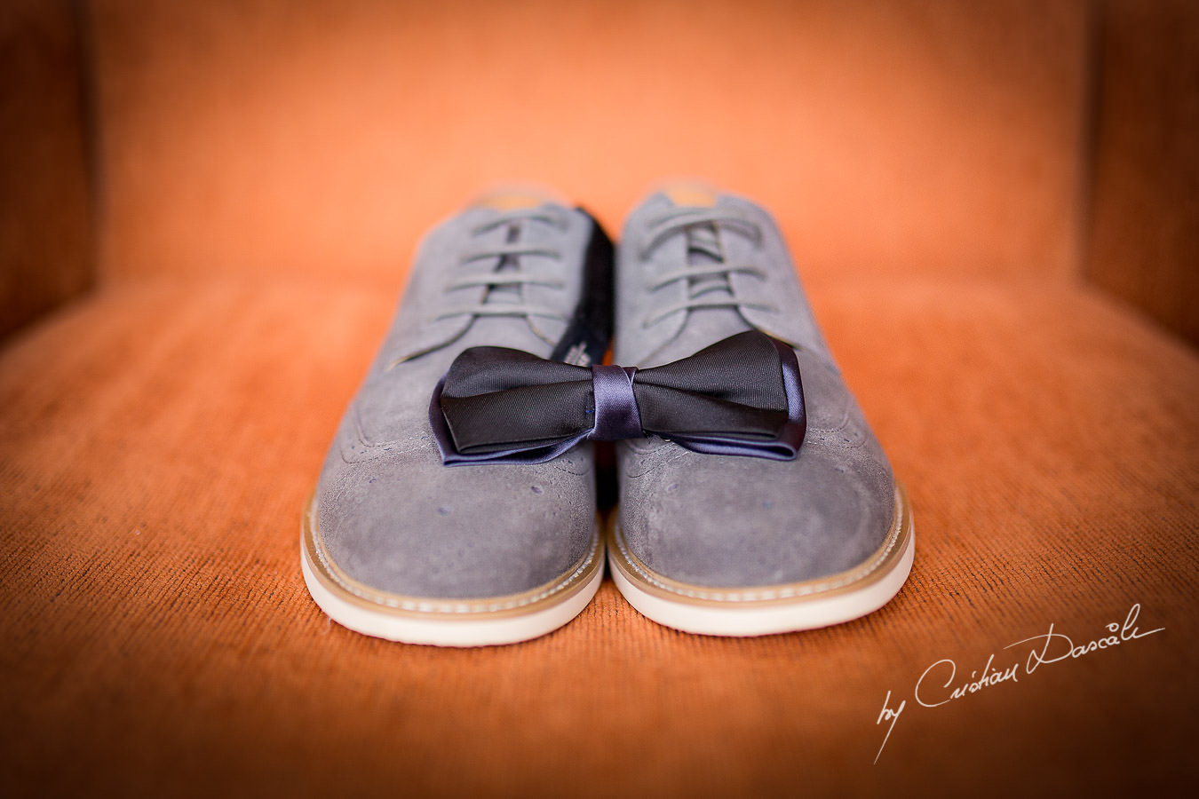 Groom's shoes and bow-tie at a Beautiful Wedding at Elias Beach Hotel captured by Cyprus Photographer Cristian Dascalu.