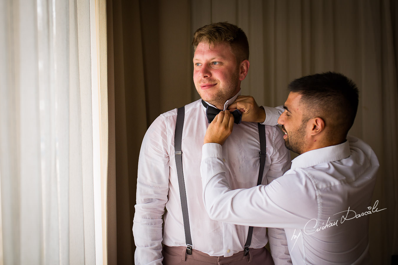 Groom and best man at a Beautiful Wedding at Elias Beach Hotel captured by Cyprus Photographer Cristian Dascalu.