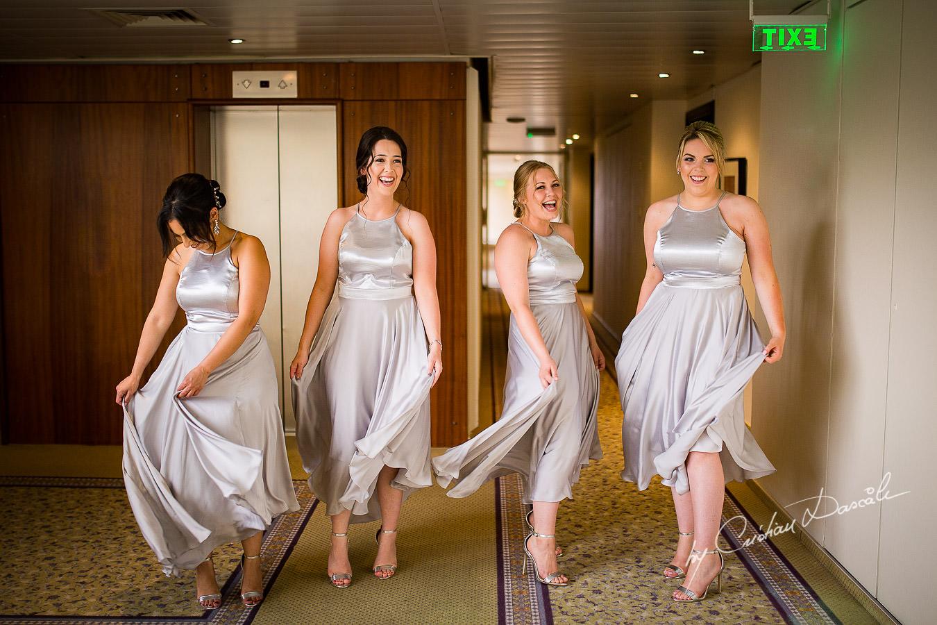 The Bridesmaids having fun during a Beautiful Wedding at Elias Beach Hotel captured by Cyprus Photographer Cristian Dascalu.