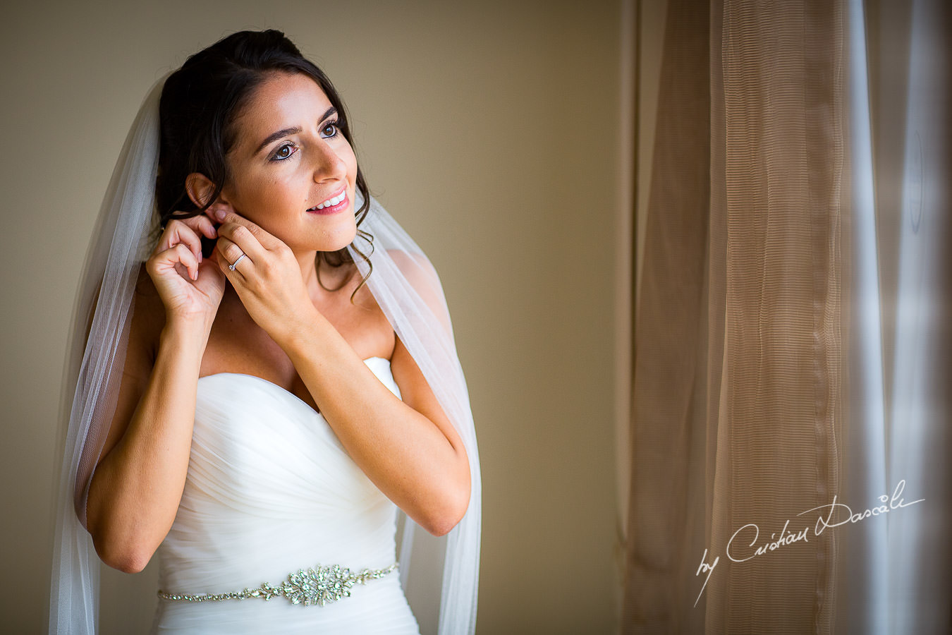 The bride getting ready during a Beautiful Wedding at Elias Beach Hotel captured by Cyprus Photographer Cristian Dascalu.