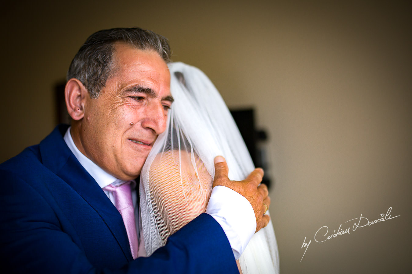 The father of the bride seeing his daughter for the first time during a Beautiful Wedding at Elias Beach Hotel captured by Cyprus Photographer Cristian Dascalu.