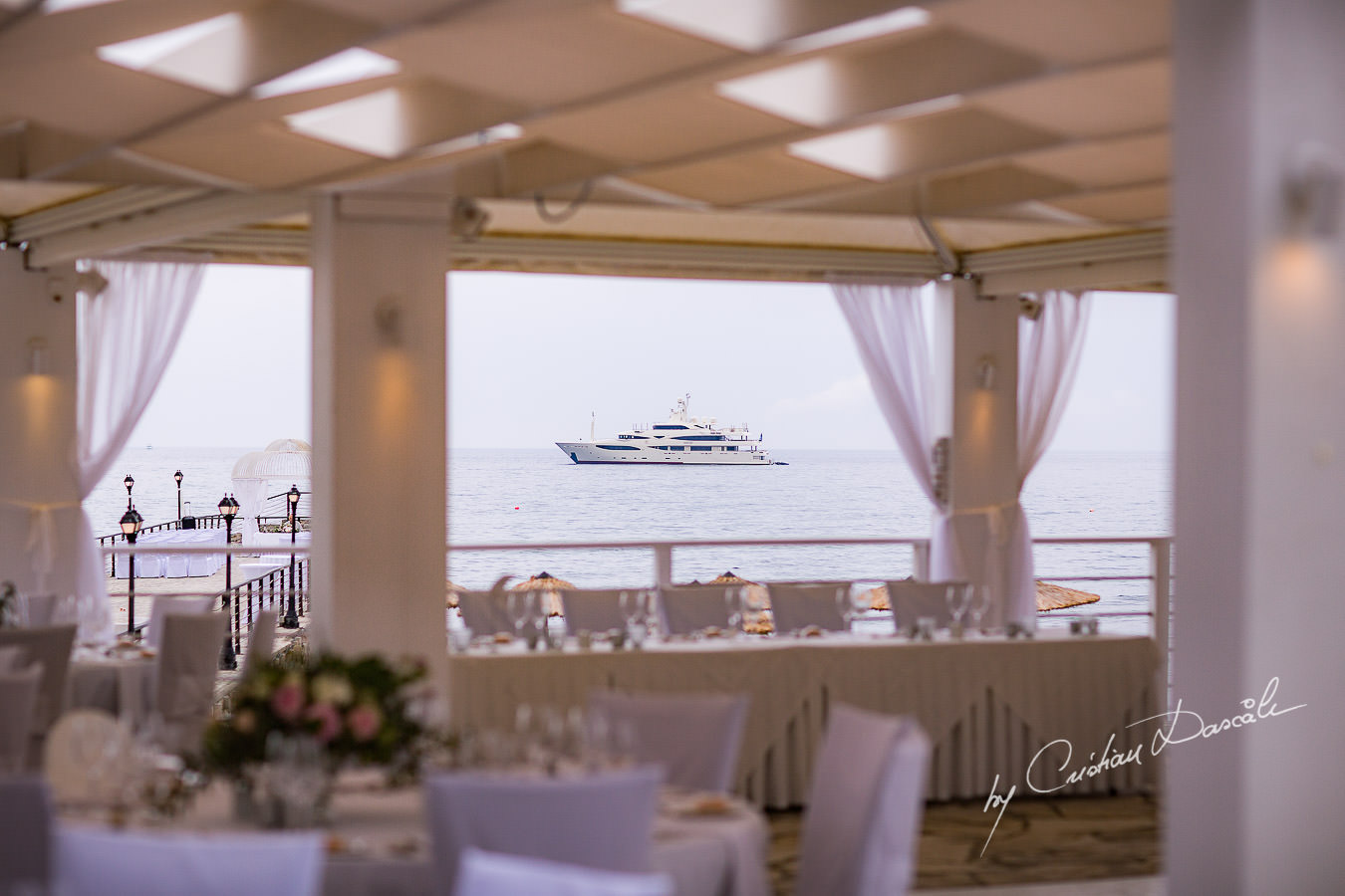 Wedding venue view over the sea during a Beautiful Wedding at Elias Beach Hotel captured by Cyprus Photographer Cristian Dascalu.