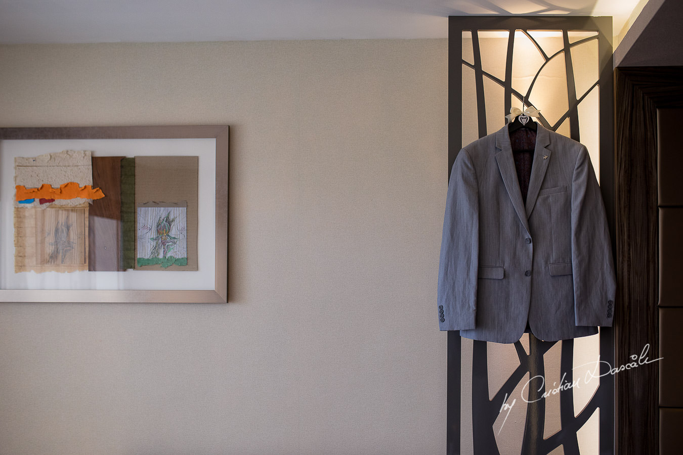 Groom's neat suit captured during an Exquisite Wedding at Asterias Beach Hotel by Cyprus Photographer Cristian Dascalu.