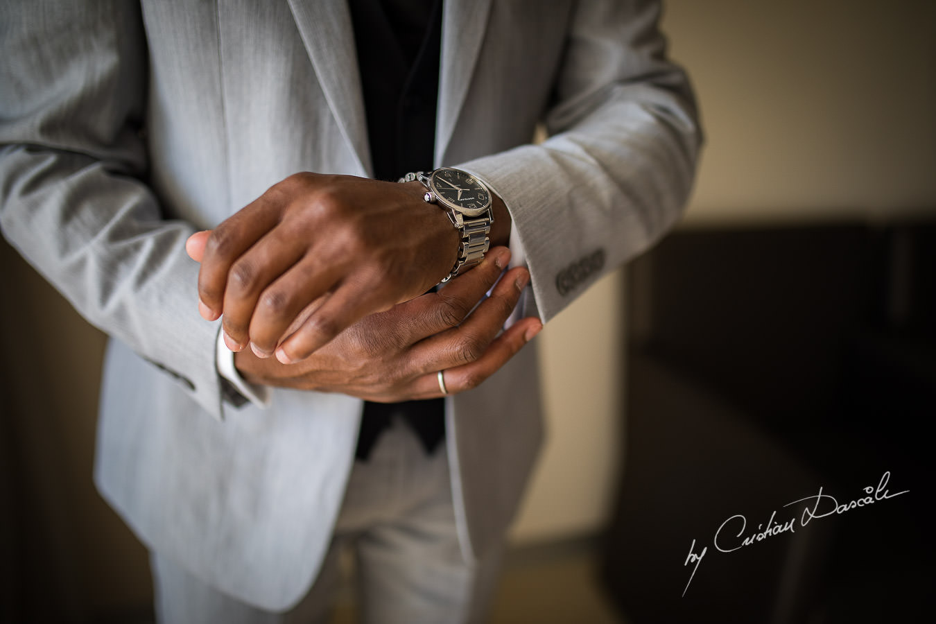 Groom closing his watch captured during an Exquisite Wedding at Asterias Beach Hotel by Cyprus Photographer Cristian Dascalu.