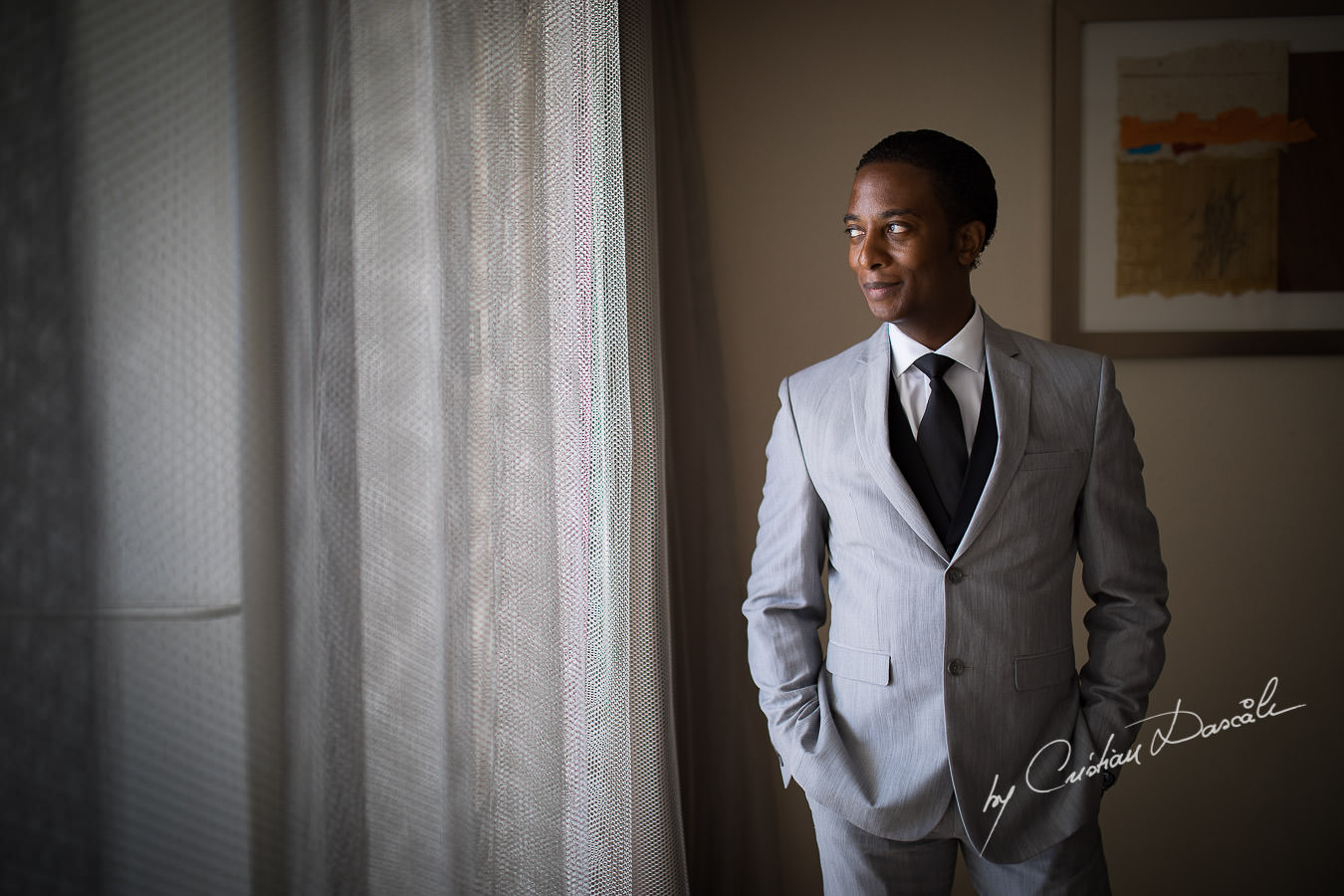 Groom portrait captured during an Exquisite Wedding at Asterias Beach Hotel by Cyprus Photographer Cristian Dascalu.