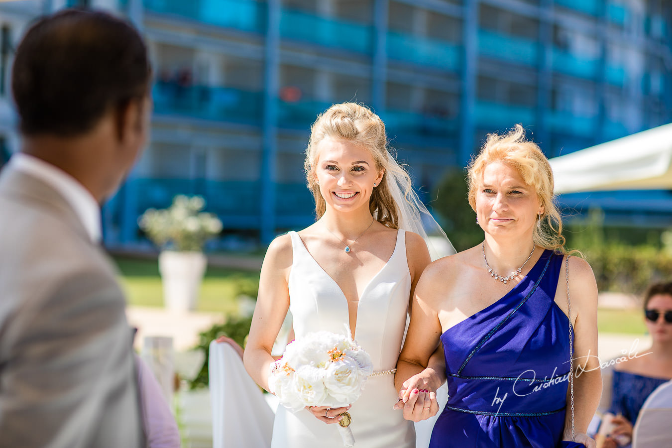 Bride arrival at an Exquisite Wedding at Asterias Beach Hotel. Photography by Cyprus Photographer Cristian Dascalu.
