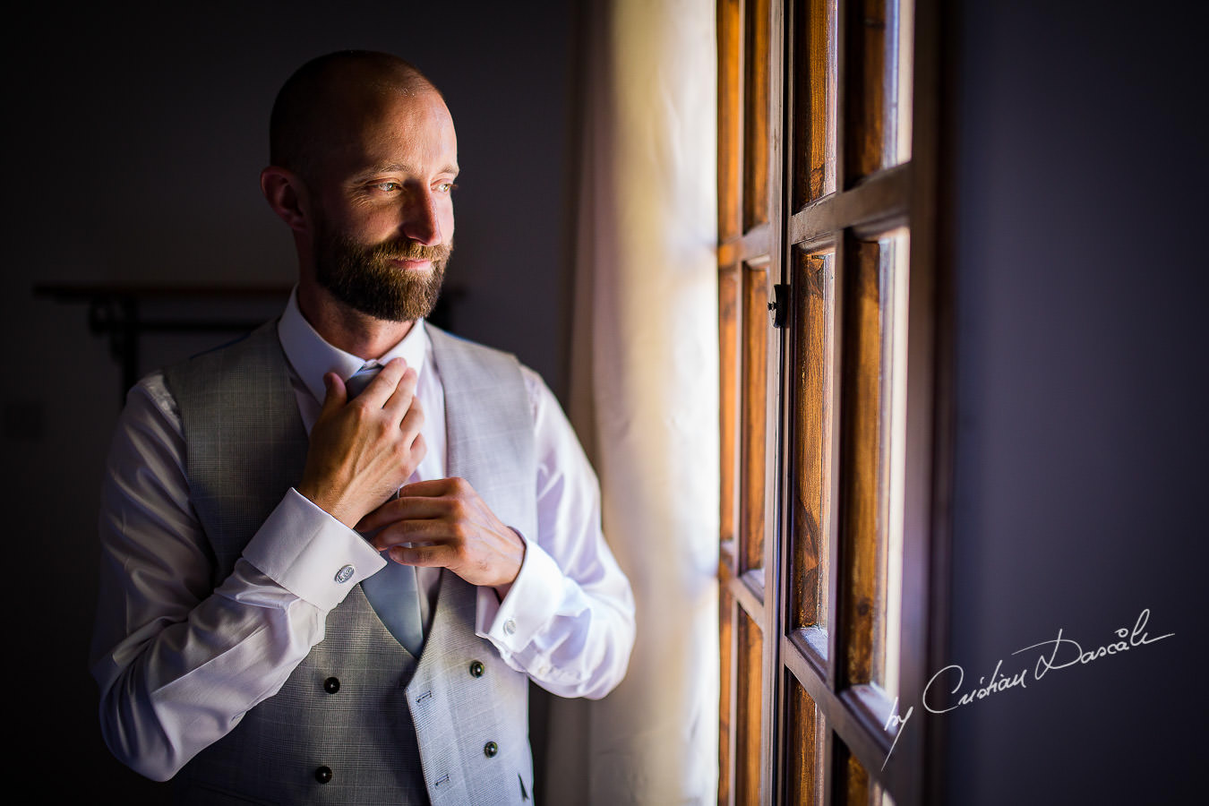 Groom portraiture captured at a Vasilias Nikoklis Inn Wedding in Paphos. Cyprus Wedding Photography by Cristian Dascalu.