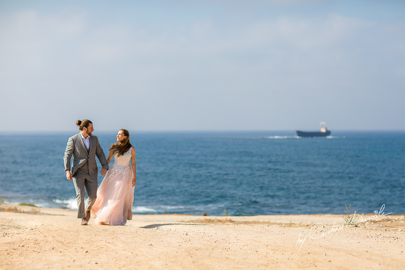 Bride and Groom's arrival, with M/V Demetrios II Shipwreck in the background, captured by Cyprus Wedding Photographer Cristian Dascalu.