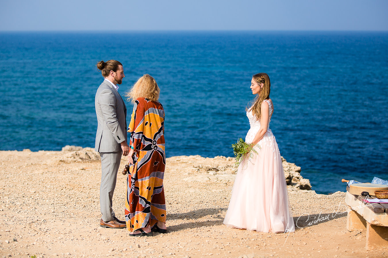 The shaman blessing the bride, moments captured by Cyprus Wedding Photographer Cristian Dascalu.