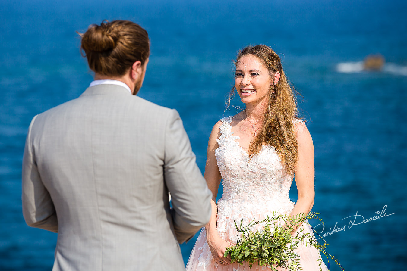 The bride and groom changing vows, moments captured by Cyprus Wedding Photographer Cristian Dascalu.