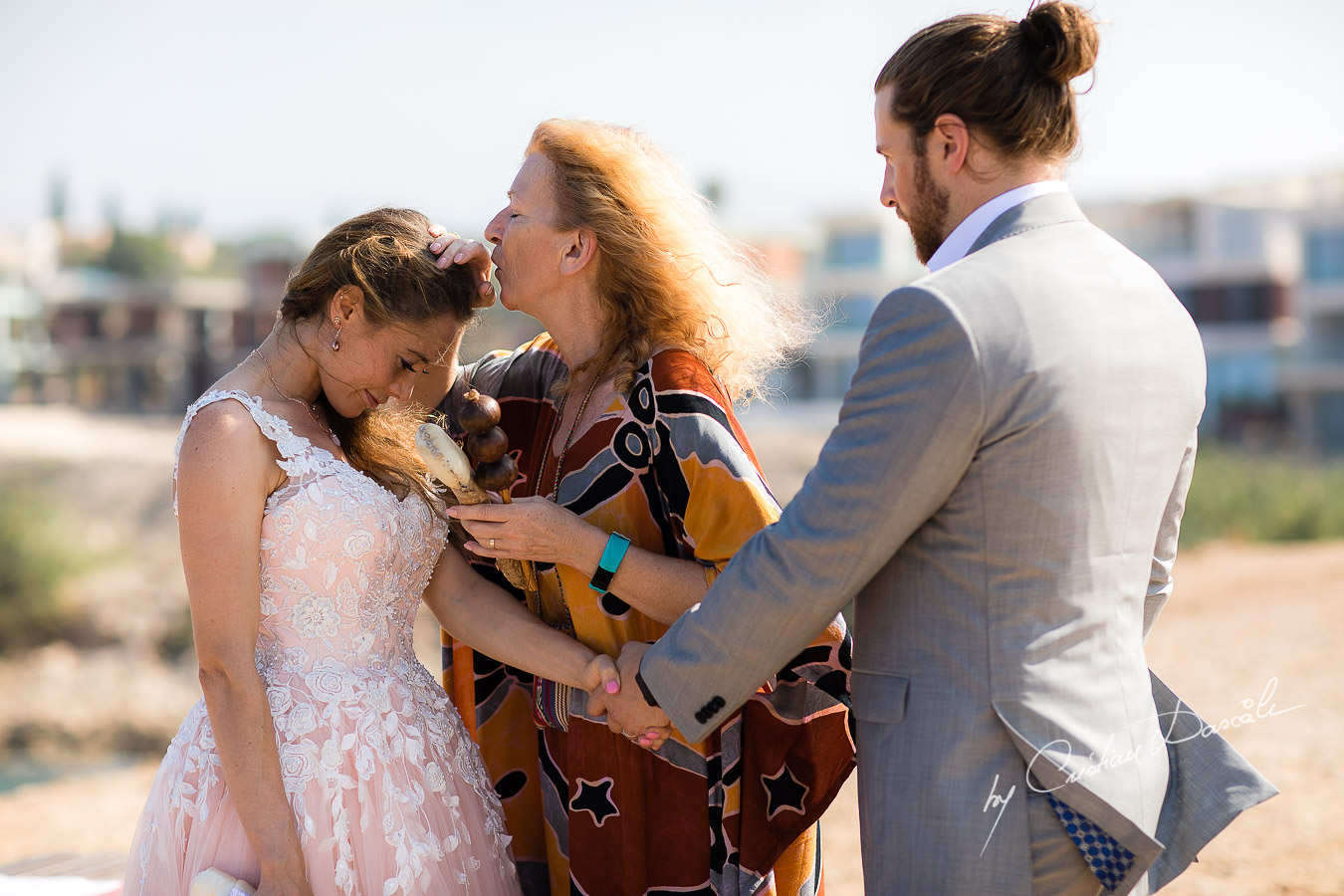 The shaman blessing the bride, moments captured at a Shamanic Wedding Ceremony by Cyprus Wedding Photographer Cristian Dascalu.