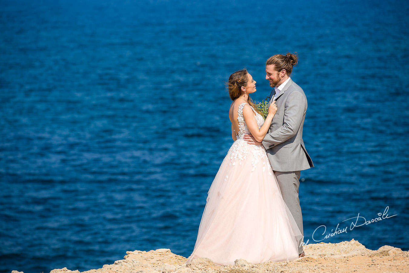 Bride and groom posing on the beach, moments captured at a Shamanic Wedding Ceremony by Cyprus Wedding Photographer Cristian Dascalu.