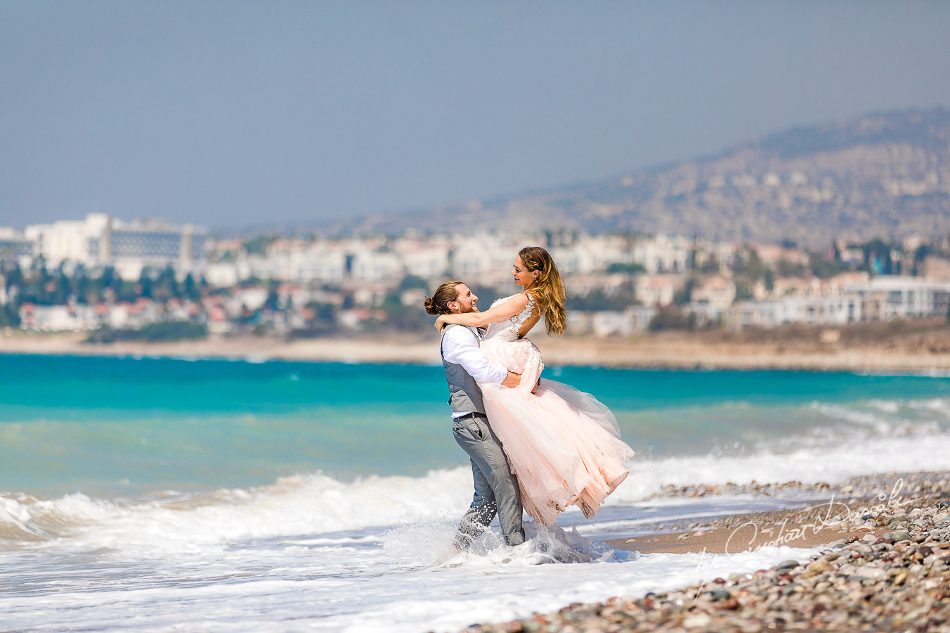 Bride and groom running naturally on the beach, moments captured at a Shamanic Wedding Ceremony by Cyprus Wedding Photographer Cristian Dascalu.