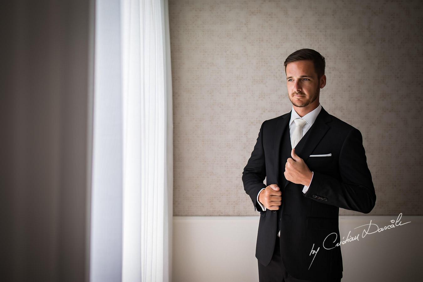 Stylish groom portraiture captured by Cristian Dascalu during an elegant Aphrodite Hills Wedding in Cyprus.
