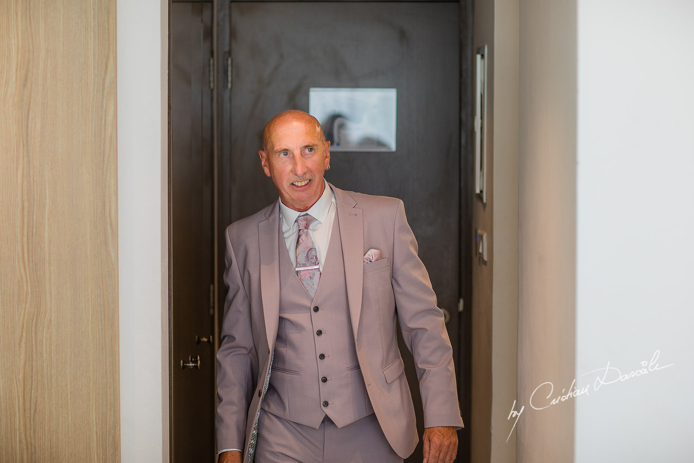 Father of the bride just before meeting the bride, moments captured by Cristian Dascalu during an elegant Aphrodite Hills Wedding in Cyprus.