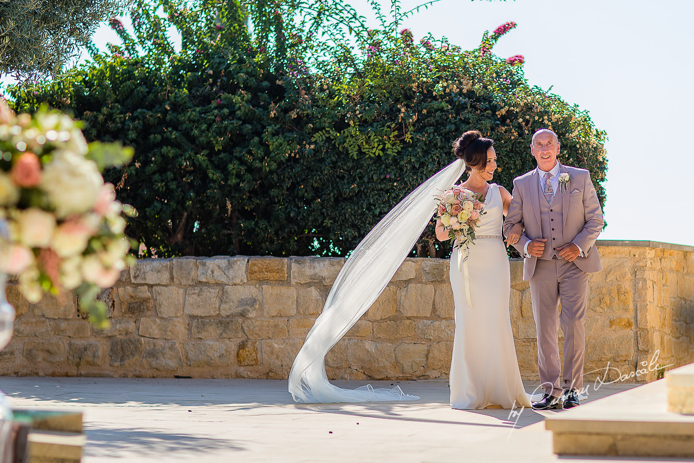 The bride arrives with her father, moments captured by Cristian Dascalu during an elegant Aphrodite Hills Wedding in Cyprus.