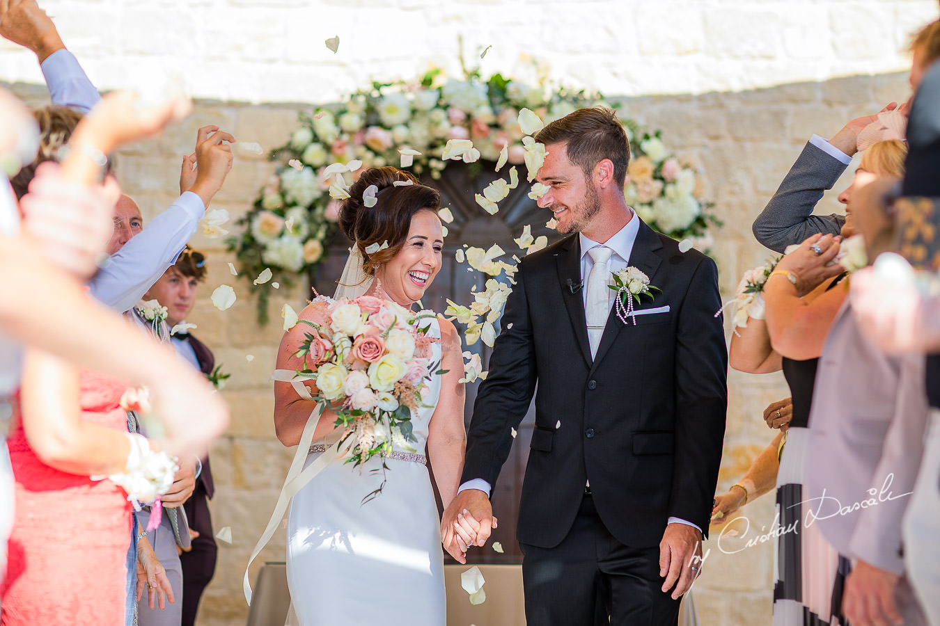 Confetti moments captured by Cristian Dascalu during an elegant Aphrodite Hills Wedding in Cyprus.