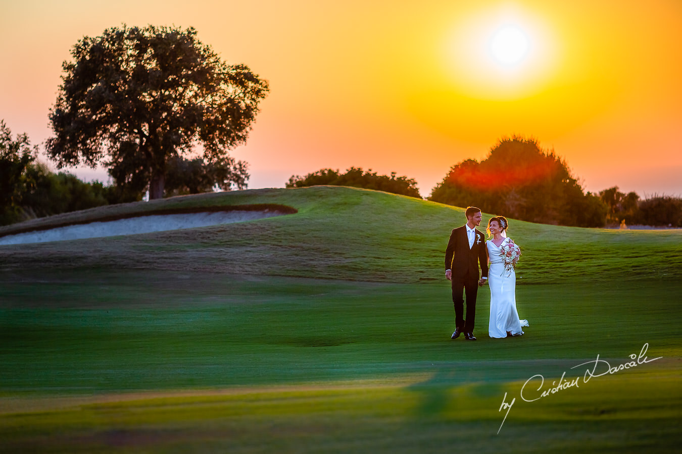 Sunset photo shoot moments captured by Cristian Dascalu during an elegant Aphrodite Hills Wedding in Cyprus.