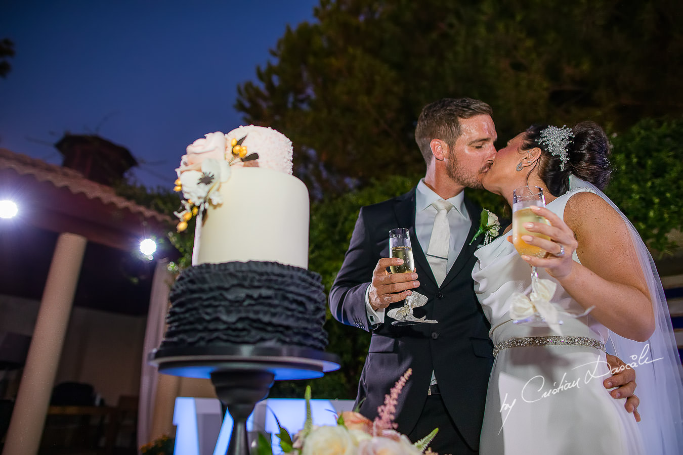 Cutting the cake moments captured by Cristian Dascalu during an elegant Aphrodite Hills Wedding in Cyprus.