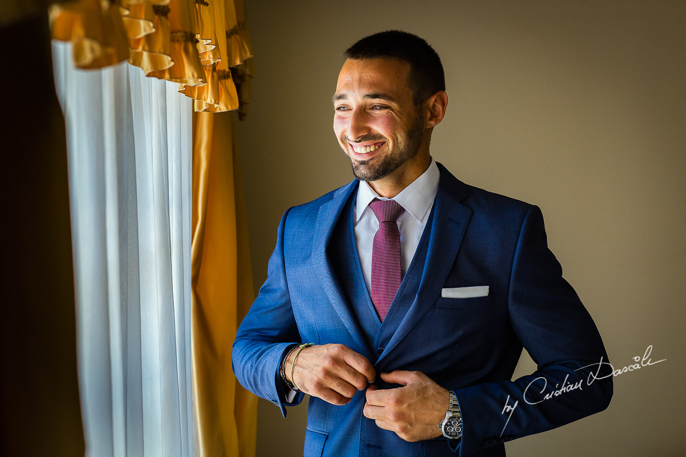 Groom's smile before his wedding, moments captured by Cyprus Wedding Photographer Cristian Dascalu at a beautiful wedding in Larnaka, Cyprus.