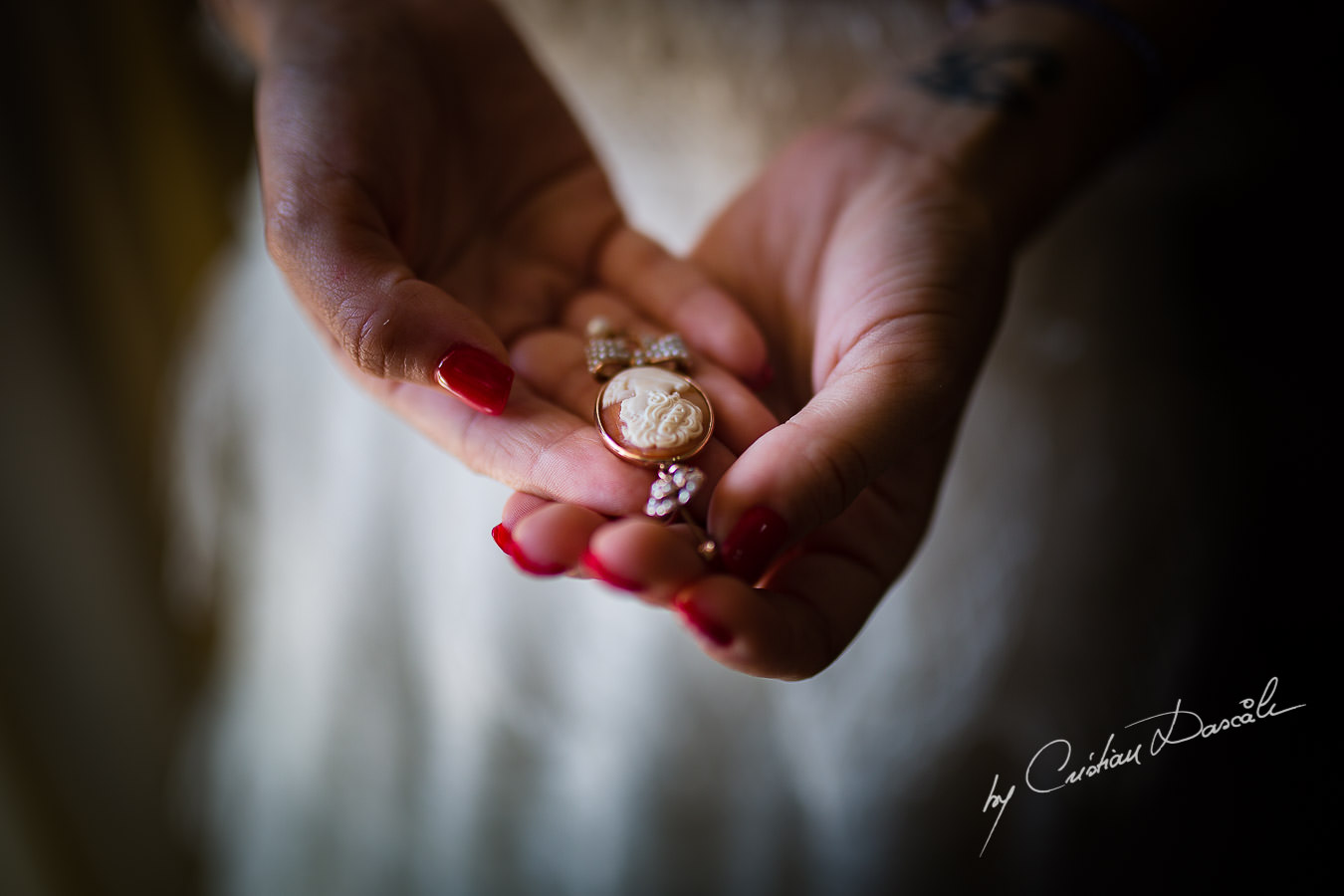 The bride`s earing, captured by Cyprus Wedding Photographer Cristian Dascalu at a beautiful wedding in Larnaka, Cyprus.