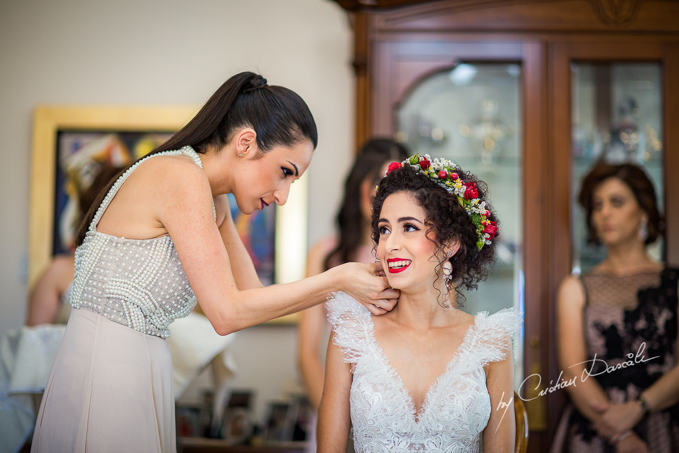 Koumera helping the bride, moments captured by Cyprus Wedding Photographer Cristian Dascalu at a beautiful wedding in Larnaka, Cyprus.