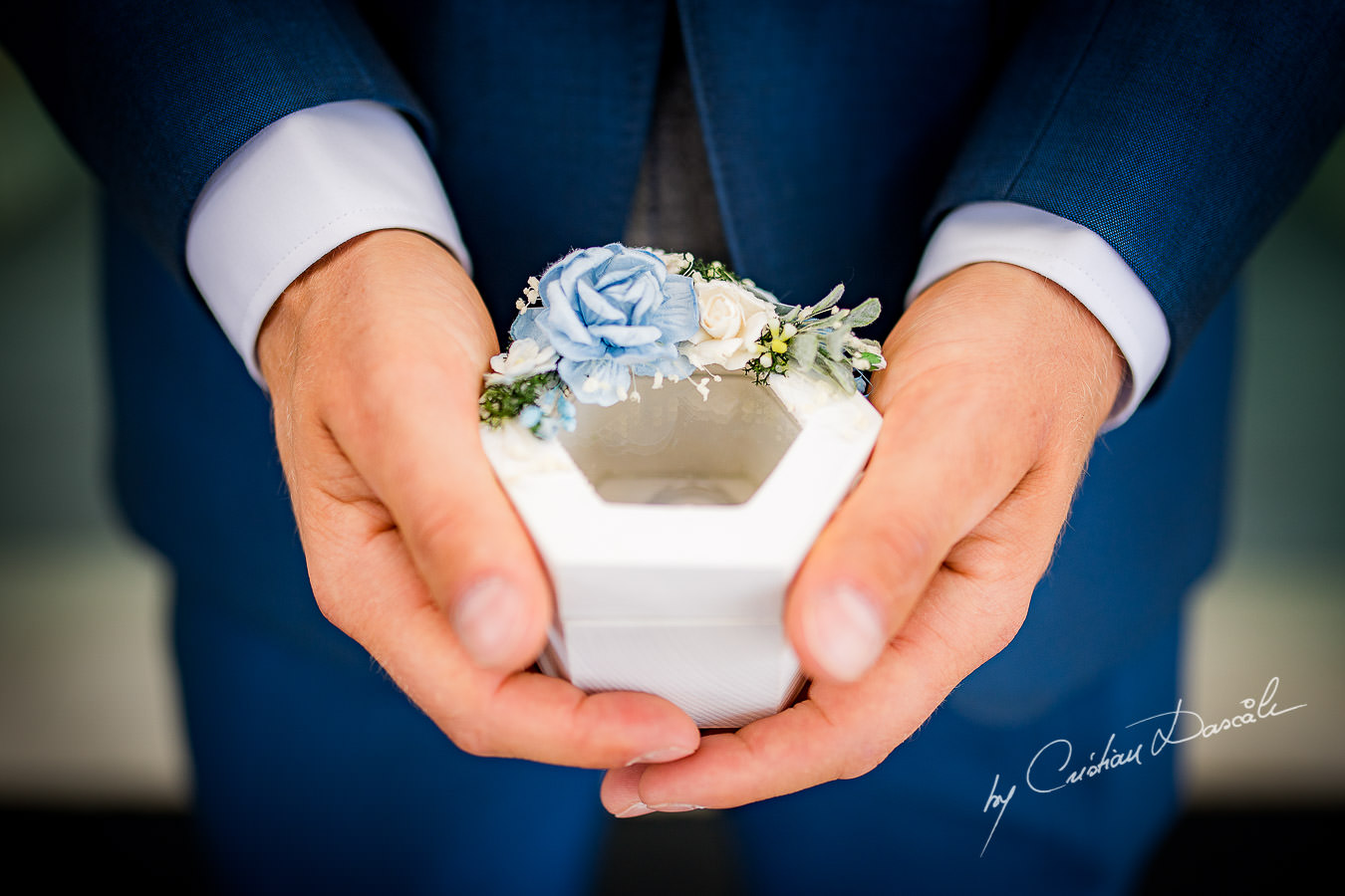 Wedding ring box carried by the best man, moments captured during an Elegant Minthis Hills Wedding, in Paphos, Cyprus.