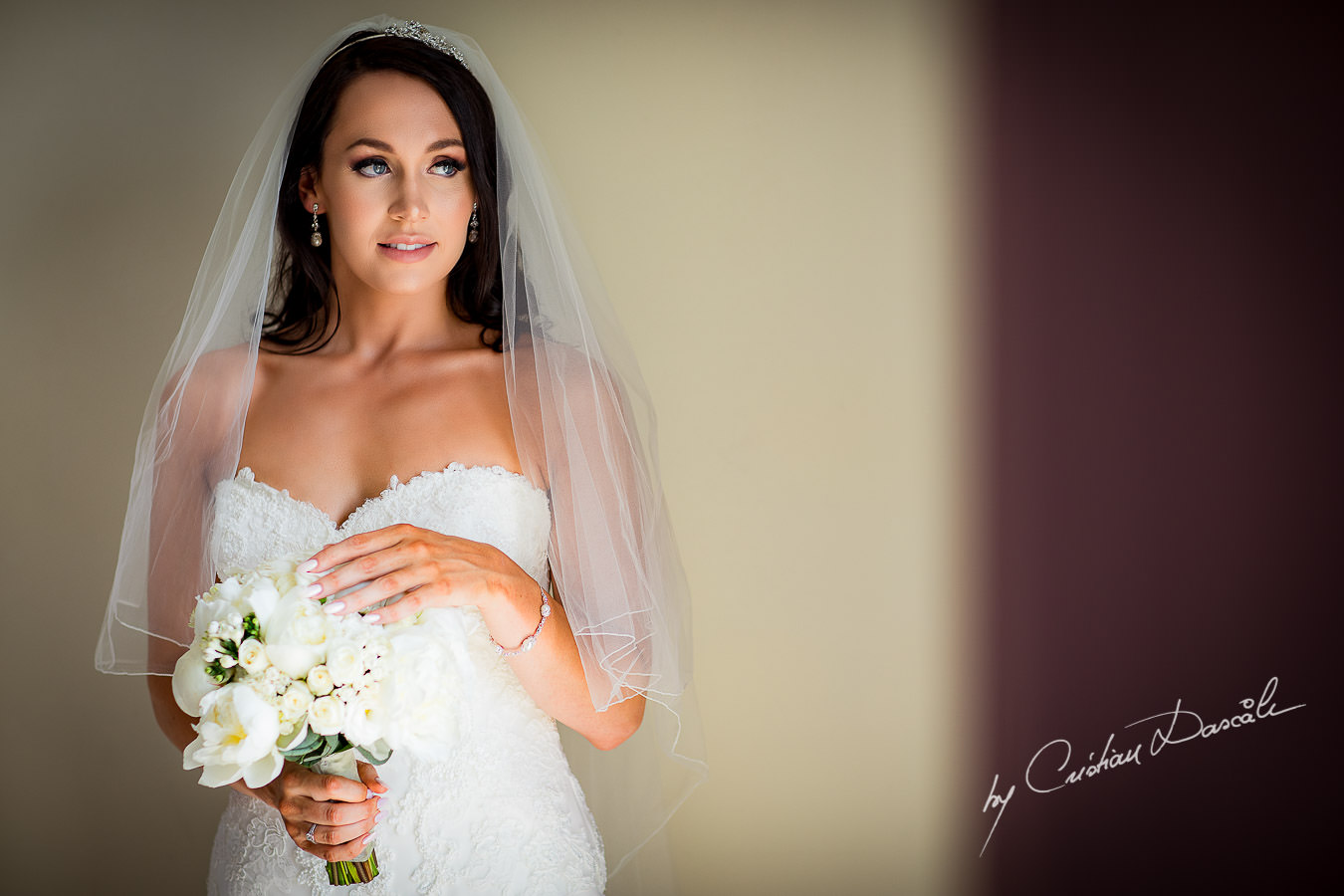 Beautiful portrait of Sara, the bride, moment captured during an Elegant Minthis Hills Wedding, in Paphos, Cyprus.